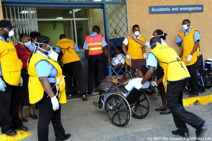 Norman Grindley/Chief Photographer  Porter at the Kingston Public hospital in Kingston kept busy as police transport workers from the Central Sorting Office of the Post and Telecoms Department in Kingston who got sick from the noxious fumes coming from the building.